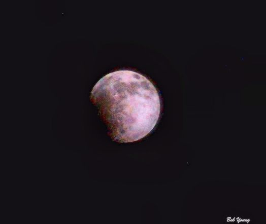 """Blood Moon Eclipse from our front area. It was a cloudy night and there was a haze covering the moon. But I think you can just see the """"red color"""" begin to form. You can definitely see the eclipse starting. Nikon D3000, Nikor 70-300mm lens shot at 300mm, 1/250 @ f13 in RAW, for those of you who want to know the details. Local tone mapped in HDR."""