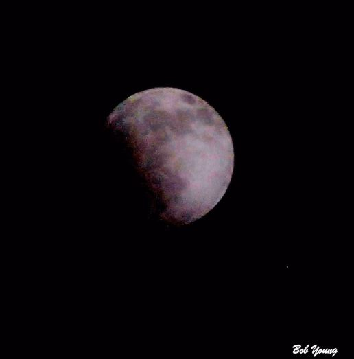 "Blood Moon Eclipse from our front area. It was a cloudy night and there was a haze covering the moon. But I think you can just see the ""red color"" begin to form. You can definitely see the eclipse starting. Nikon D3000, Nikor 70-300mm lens shot at 300mm, 1/250 @ f13 in RAW, for those of you who want to know the details."
